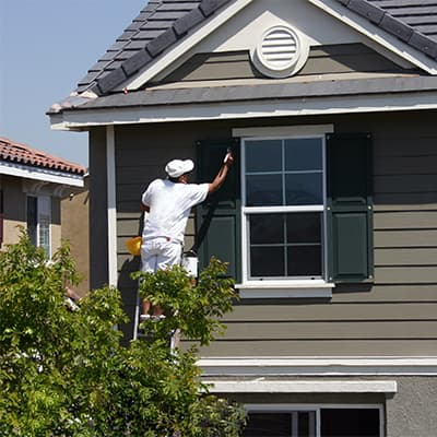 Painter providing exterior house painting services